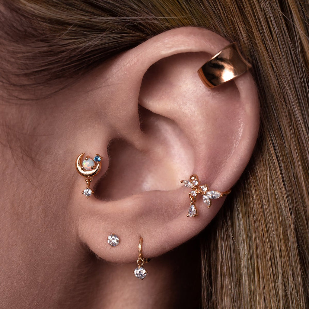 Luminary Moon Tragus Helix & Conch Piercing on model - rose gold