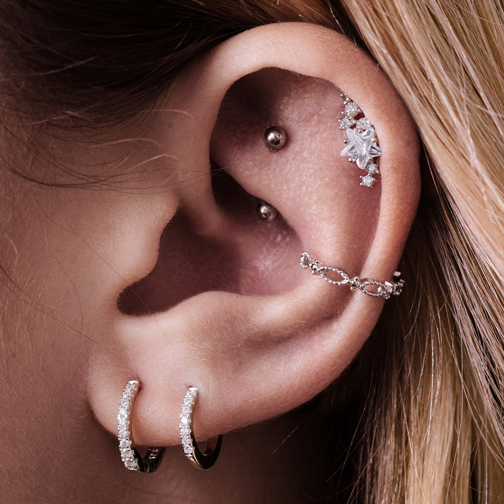 Milkyway Stars Tragus Helix & Conch Piercing on model - silver