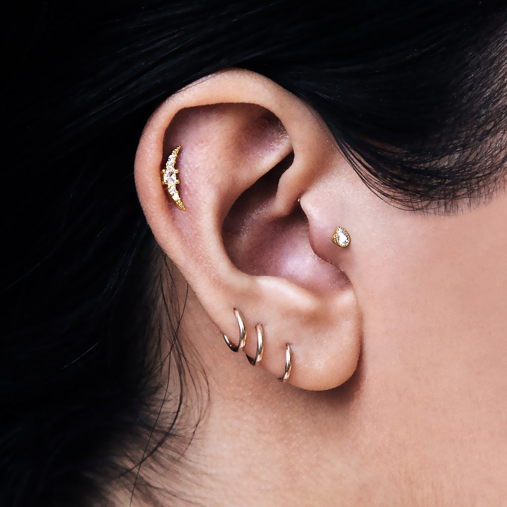 Moonrise Sparkle Tragus Helix & Conch Ear Piercing on model - gold