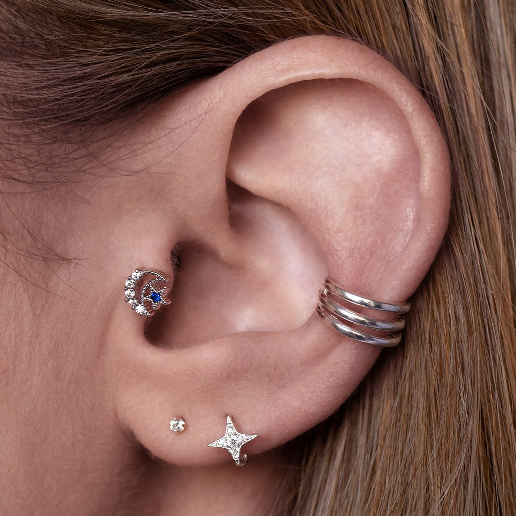 Noctis Moon Tragus Helix & Conch Piercing on model - silver