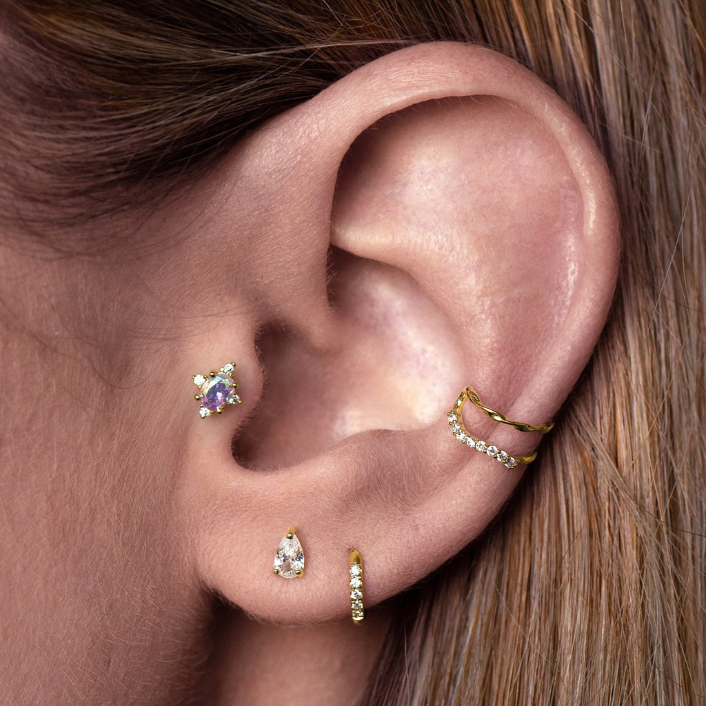 Oasis Tragus Helix & Conch Piercing on model - gold