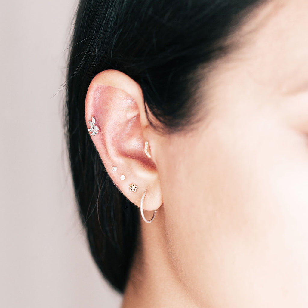 Petals Flower Tragus Helix & Conch Piercing on model - silver