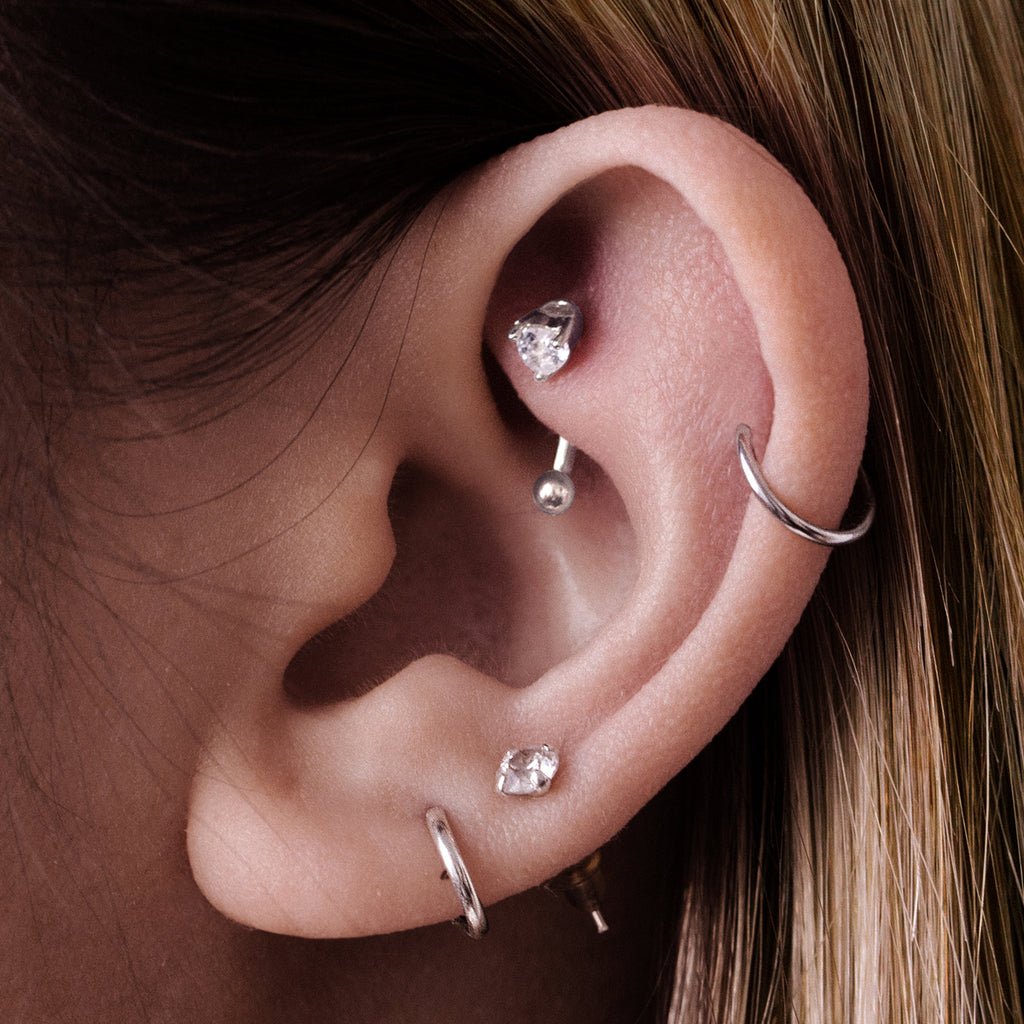 Pulse Heart Gem Daith & Rook Ear Piercing on model - silver