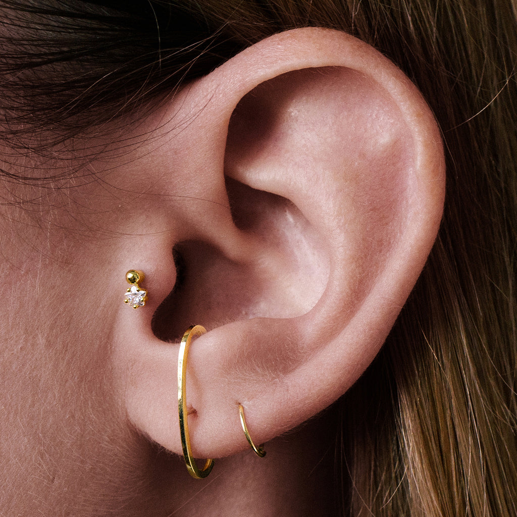 Stargaze Tragus Helix & Conch Ear Piercing on model - gold