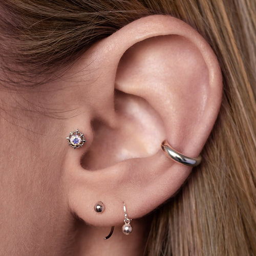 Stasis Tragus Helix & Conch Piercing on model - silver
