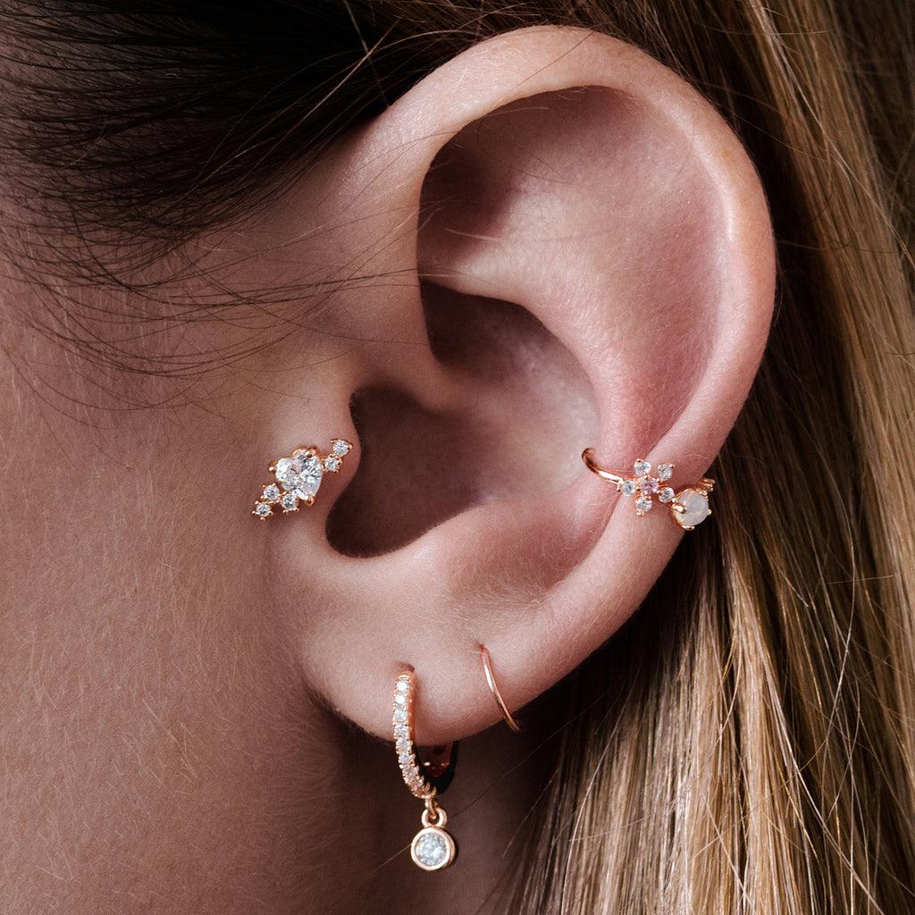 Summer Love Tragus Helix & Conch Piercing on model - rose gold