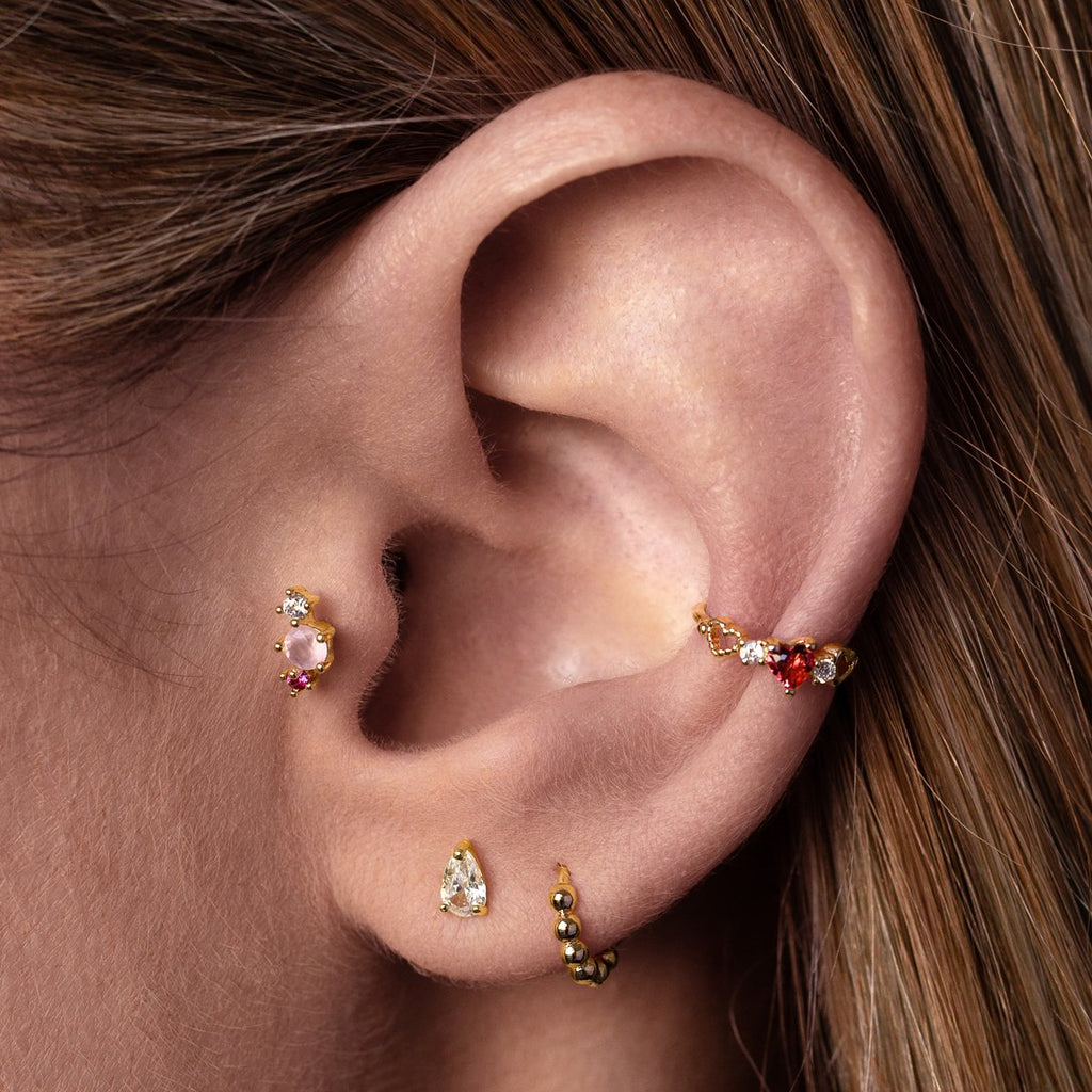 Sunrise Tragus Helix & Conch Piercing on model - gold