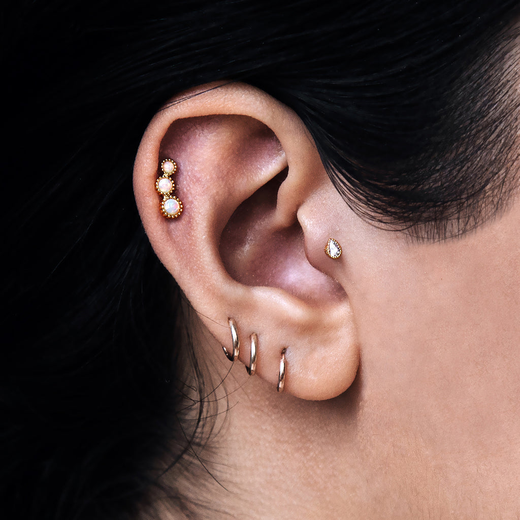 Crystal Teardrop Tragus Helix & Conch Ear Piercing on model - gold