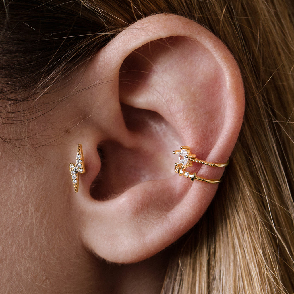 Thunder Bolt Tragus Helix & Conch Ear Piercing on model - gold