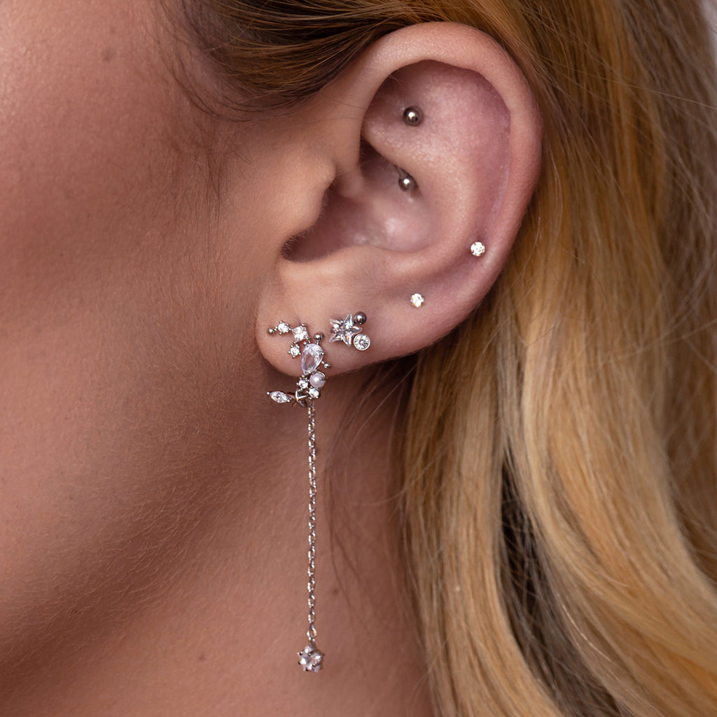 Cosmic Star Stud Earrings on model - crystal