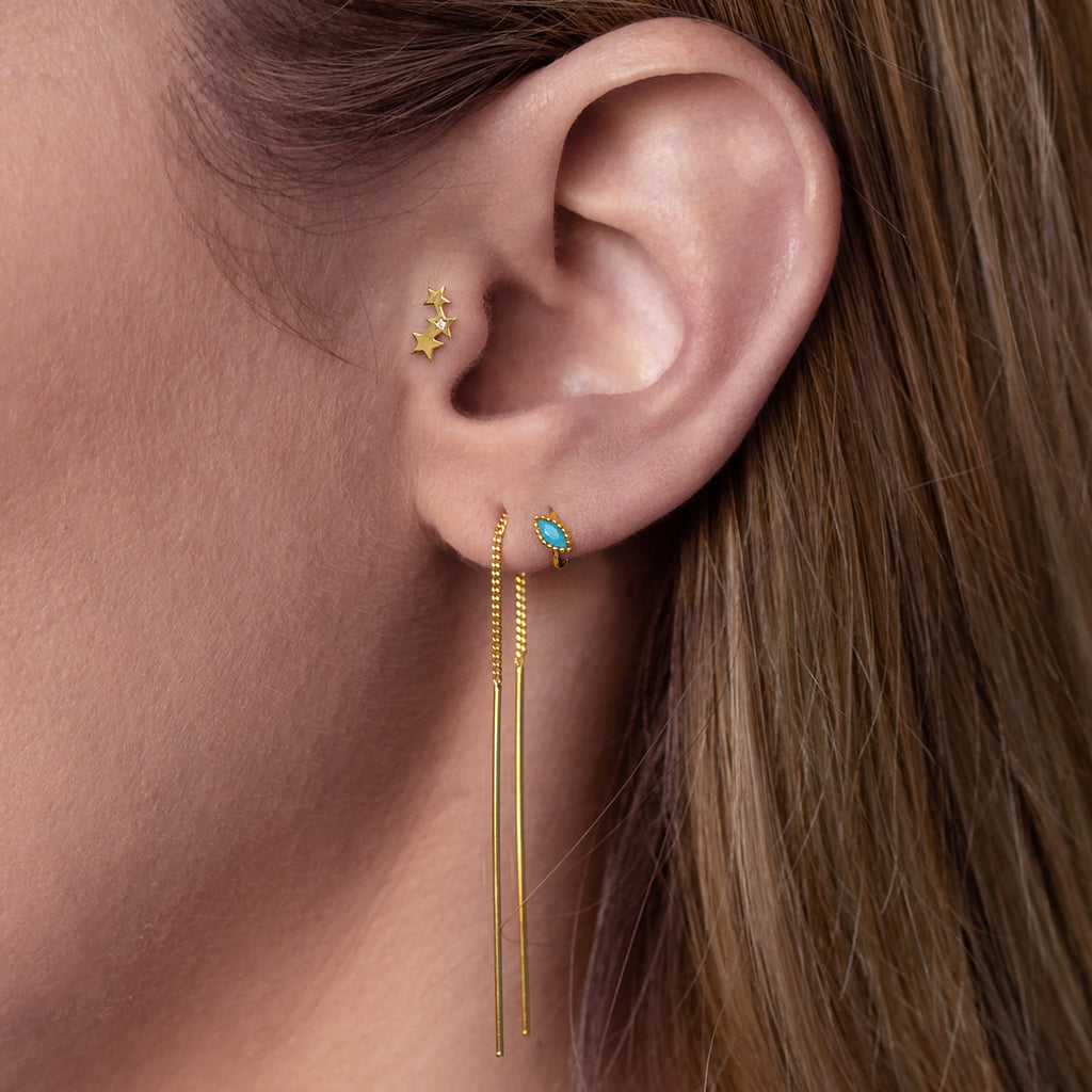 Maxim Huggie Earrings on model - gold
