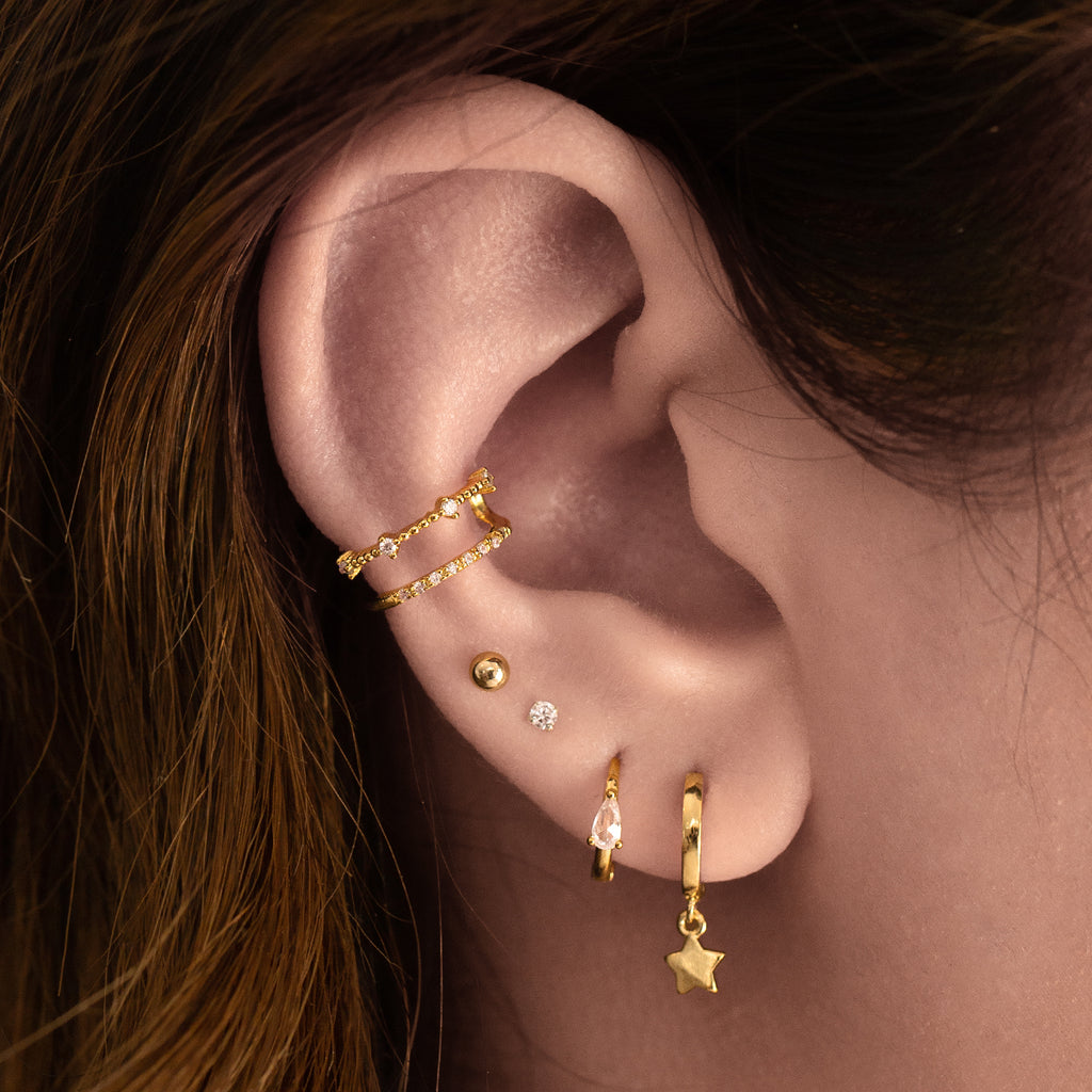 Mini Star Sleeper Earrings (huggie) on model - gold