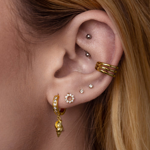 Shelby Seashell Huggie Earrings on model - gold
