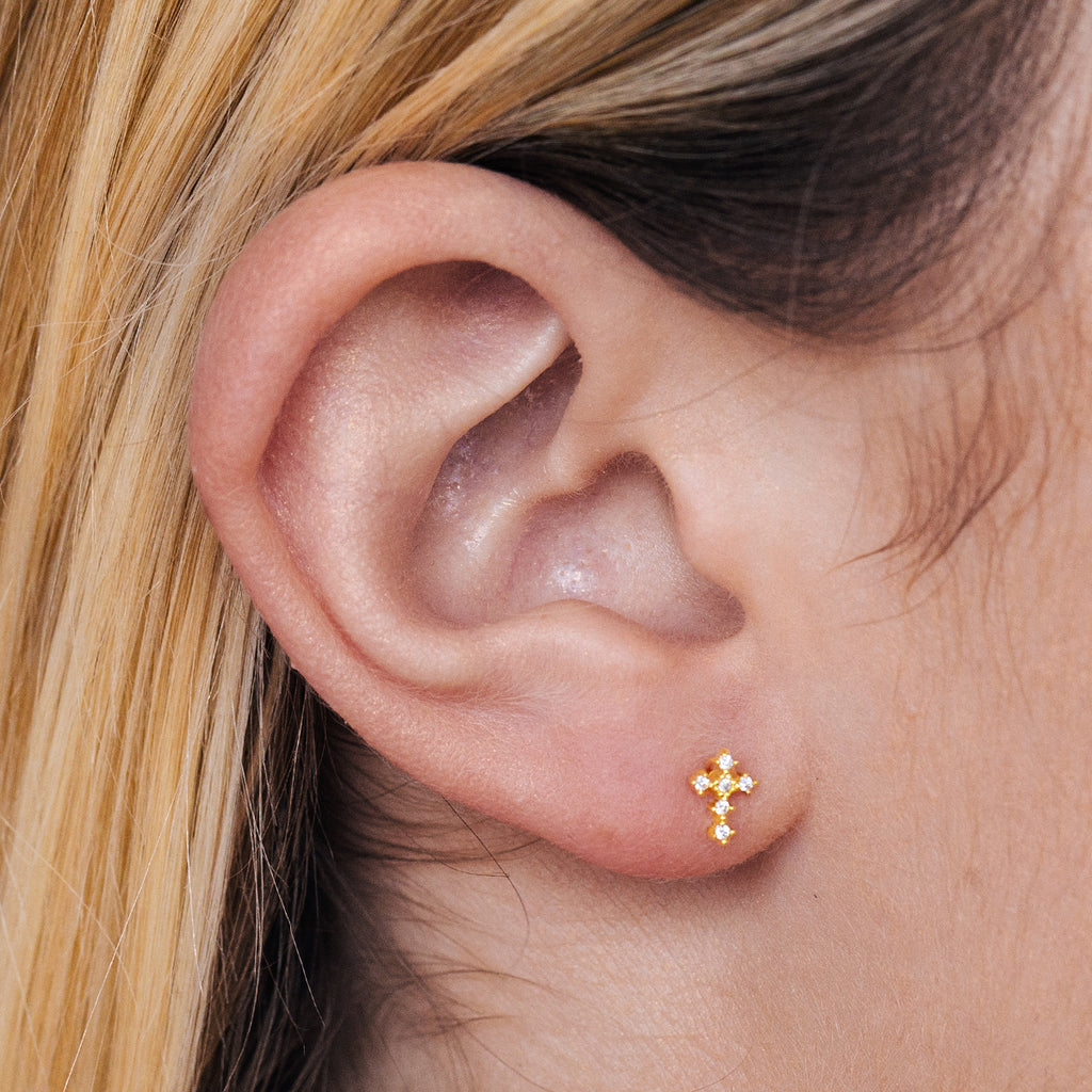 Diamonte Cross Stud Earrings on model - gold