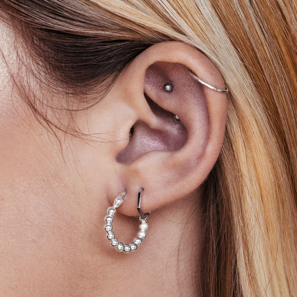 Flux Hoop Earrings on model - sterling silver