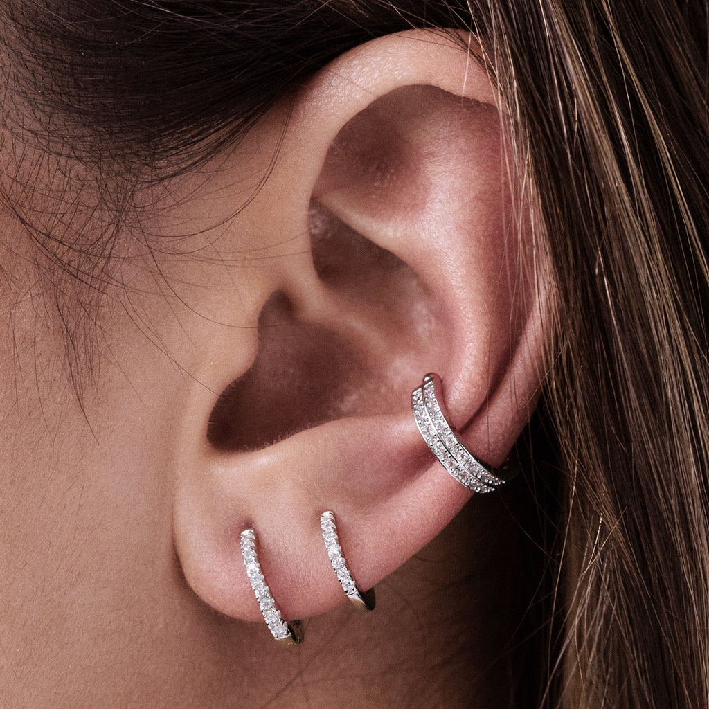 Gemini Huggie Hoop Earrings on model - sterling silver