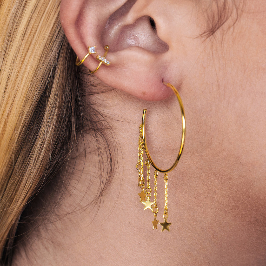 Meteor Shower Star Hoop Earrings on model - gold