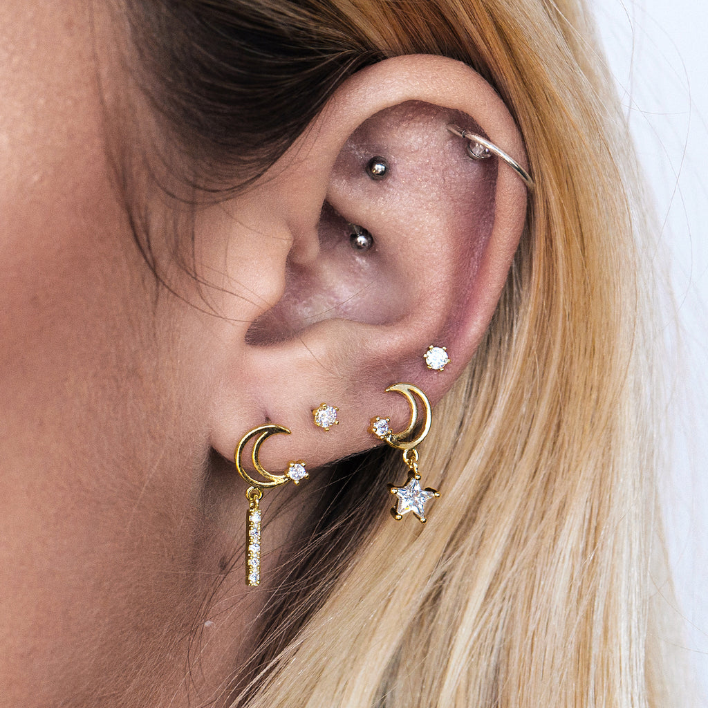 Night Shade Star & Moon Earrings on model - gold