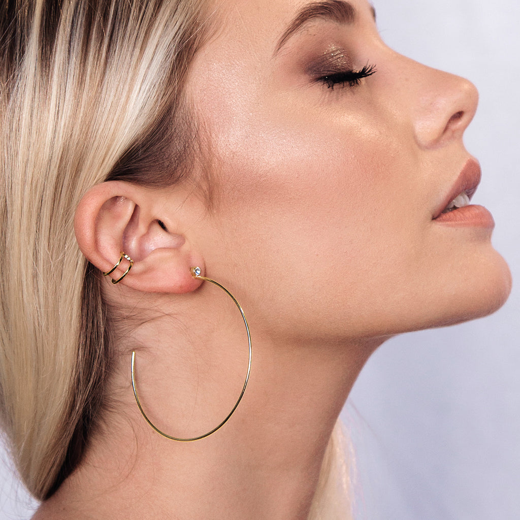 Storm Hoop Earrings on model 2 - gold