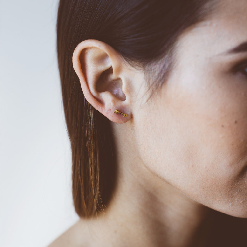 Arrow Stud Earrings on model - gold