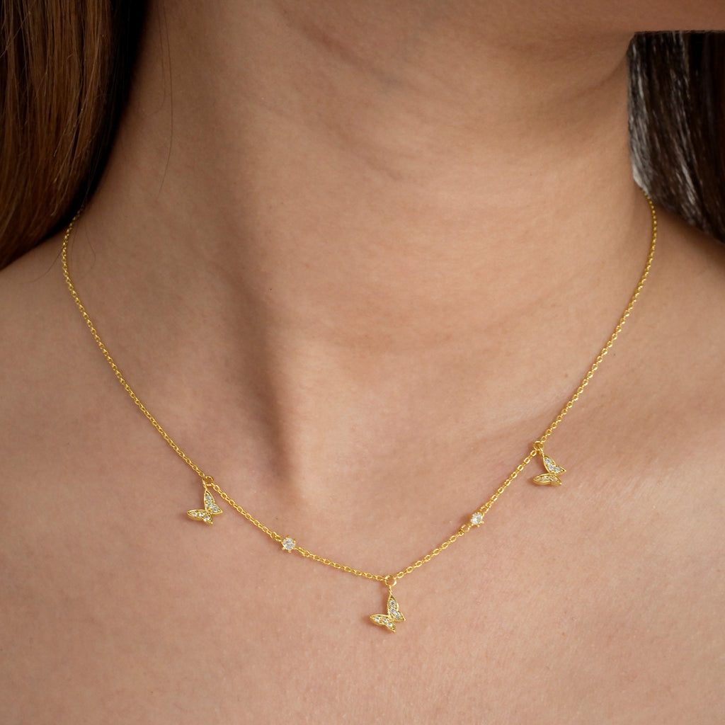 Flutter Butterfly Necklace on model - gold