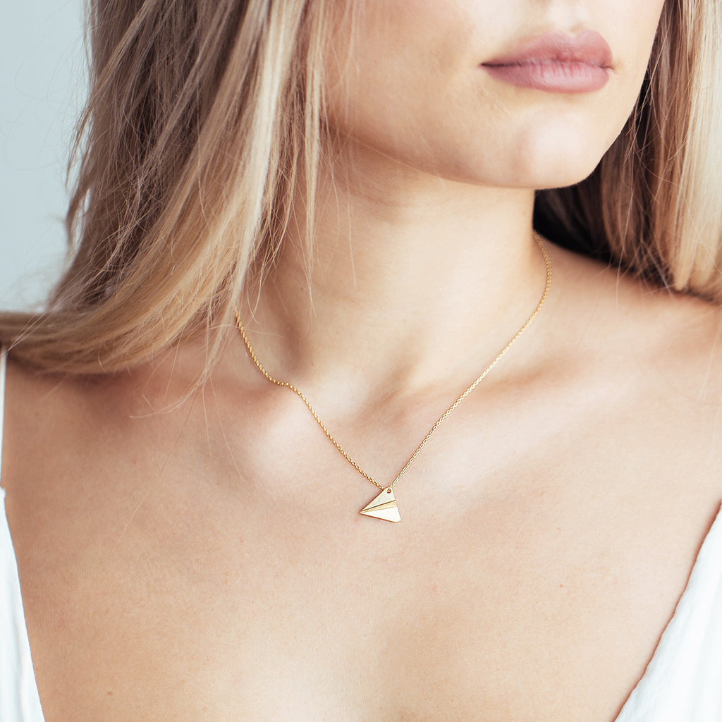 Paper Plane Necklace on model - gold