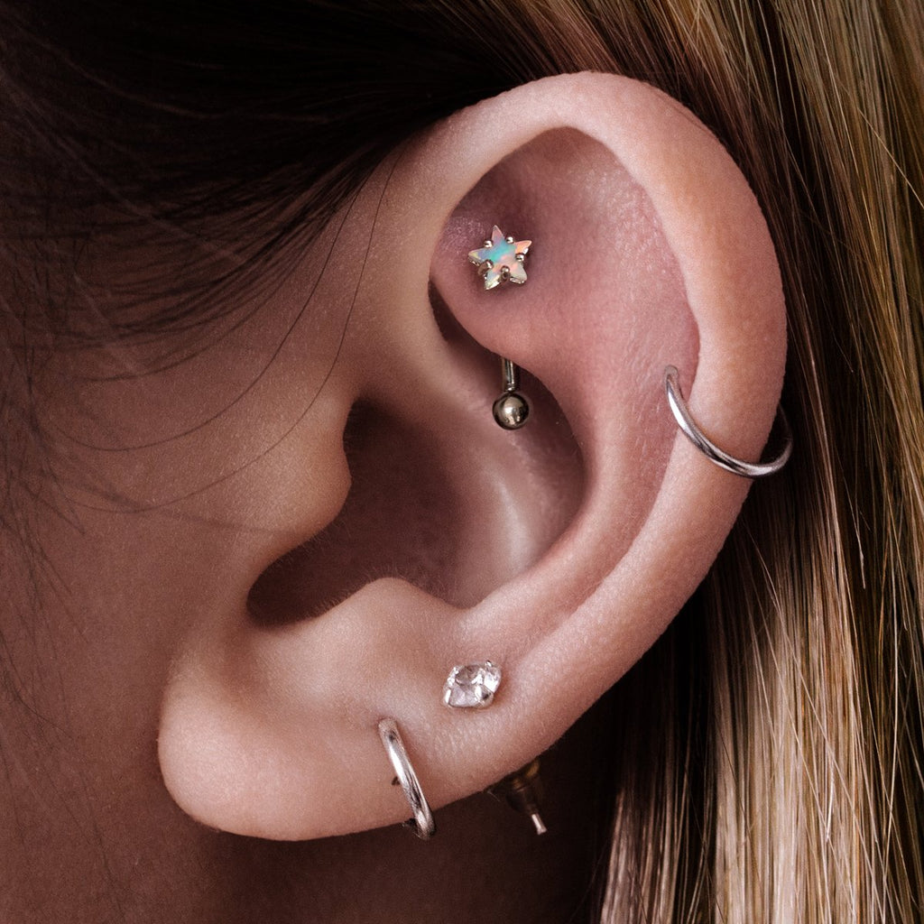 Astro Star Daith & Rook Ear Piercing on model - silver