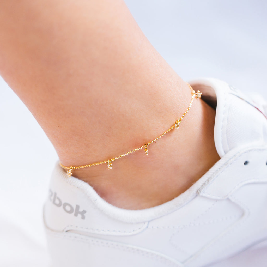 Daisy Chain Gem Anklet on model - gold