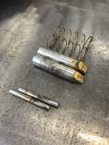 pull the climbing pins out first, and then compress the springs to remove  them  inspect your climbing pins for any unusual or excessive wear, as this  may be