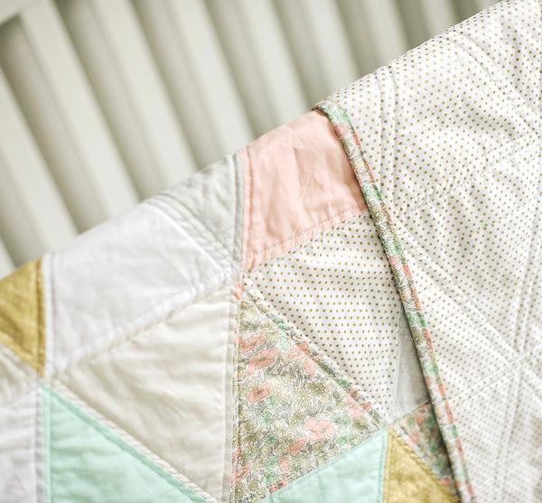 beautiful handmade feminine quilt with a Sprint flair
