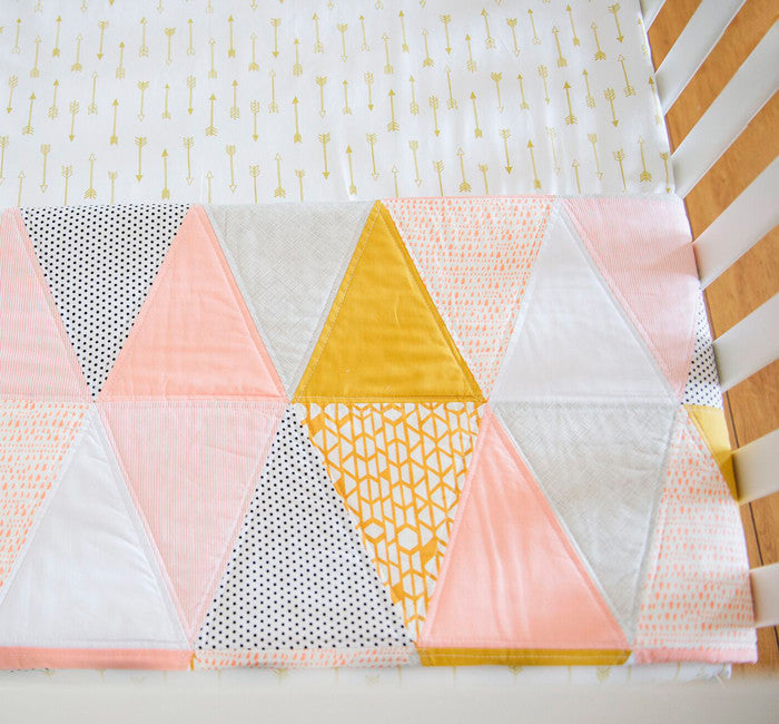 beautiful handmade feminine girl quilt with coral mustard grey and white hues