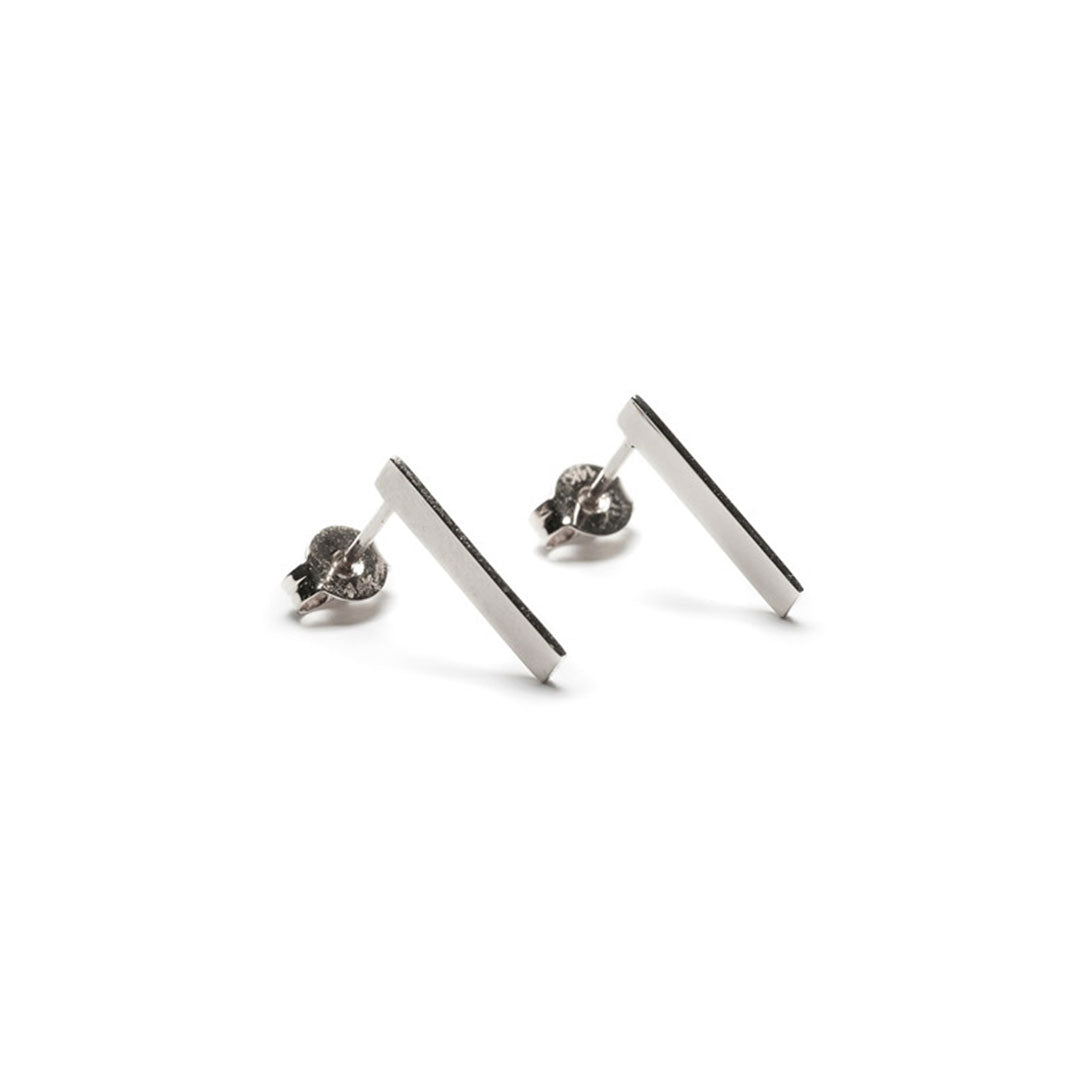 minimalist silver jewelry. edge earrings. the straits finery.