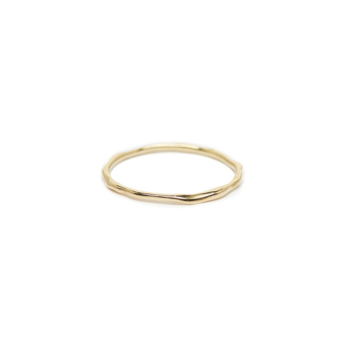 The Straits Finery minimalist stacking ring in 14k solid gold with organic shape