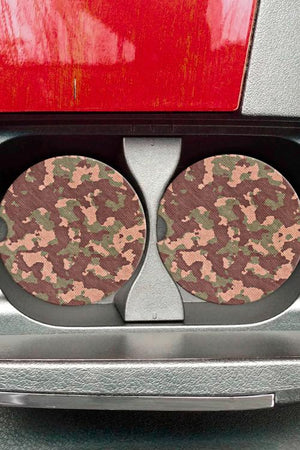 Two Camouflage Car Coasters sitting in car cup holder console