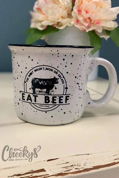 Cheekys Eat Beef Ceramic Speckle Mug on shelf with fall decor