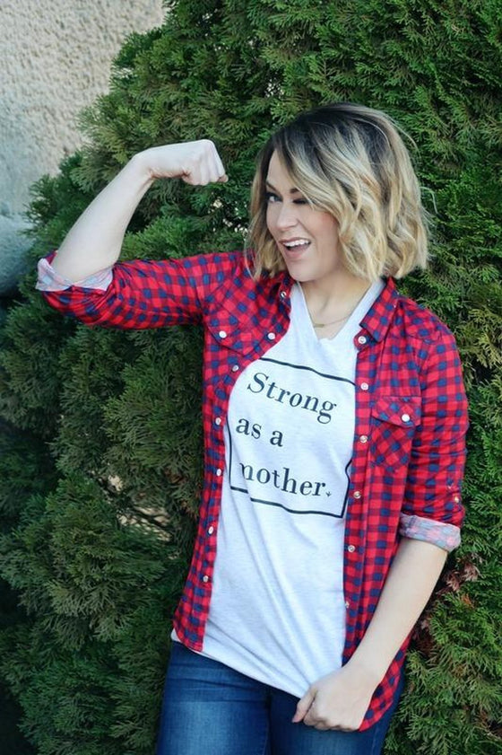 Strong as a Mother Graphic Tee, Strong as a Mother Tee, strong as a mother shirt, strong as a mother, strong as a mother tshirt, mother tee, mother top, mother tshirt, cute mom shirt, cute mom tee, mom tee, vneck mom tee, vneck mom shirt, mom vneck tee, mops mom tee, mops mom shirt, mops motherhood shirt, rural tee, rural top, rural apparel, mom, mom gift, missouri boutique, rural boutique, rural bliss, rural haze, rural brand, kc boutique, kansas city boutique, mothers day gift, mothers day tee