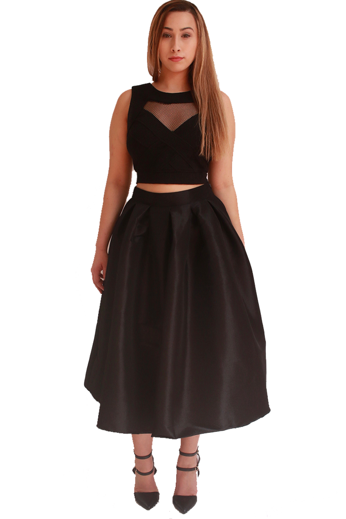 Puffy black skirt - Puffy black skirt with fitted waist band. Reaches below knees I'd recommend for a XL-2x. But not large enough if you're more a 3x ALL ORDERS COME .