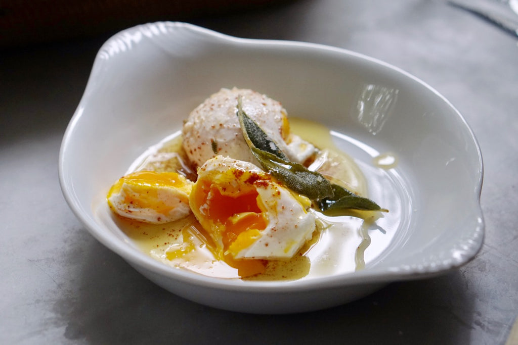 Poached eggs with browned butter and crispy sage