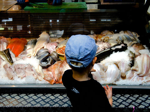Boy at fish market in Copenhagen