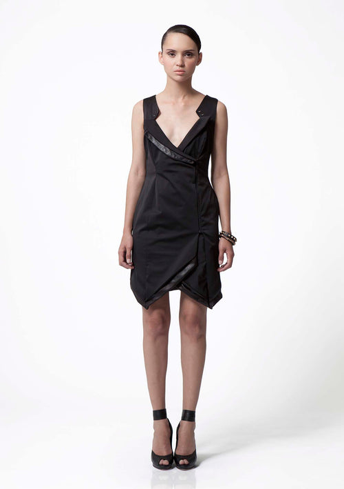 Knee length, modern, black cotton dress with a fold over the front