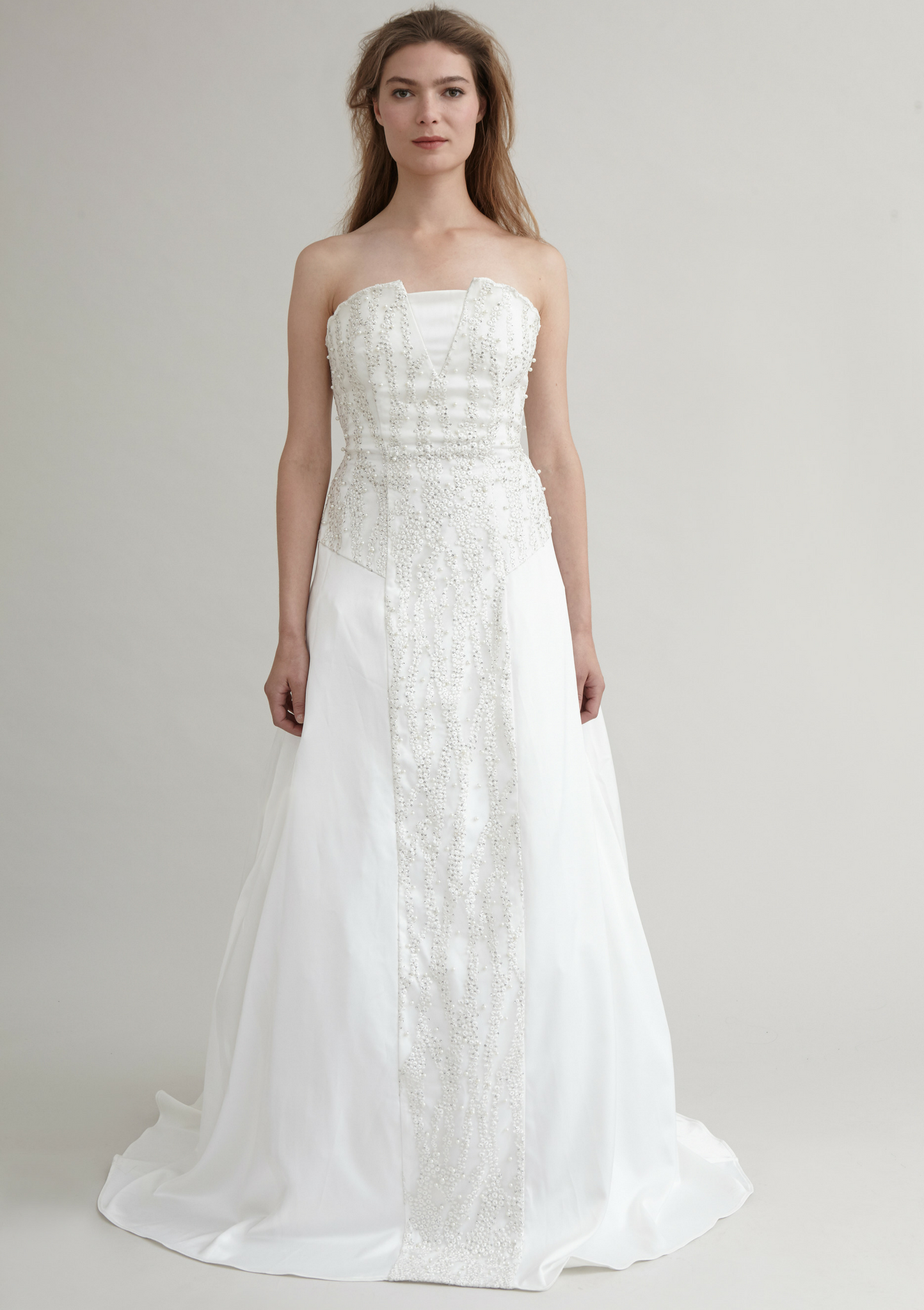 Strapless bridal gown detailed with lace and pearls
