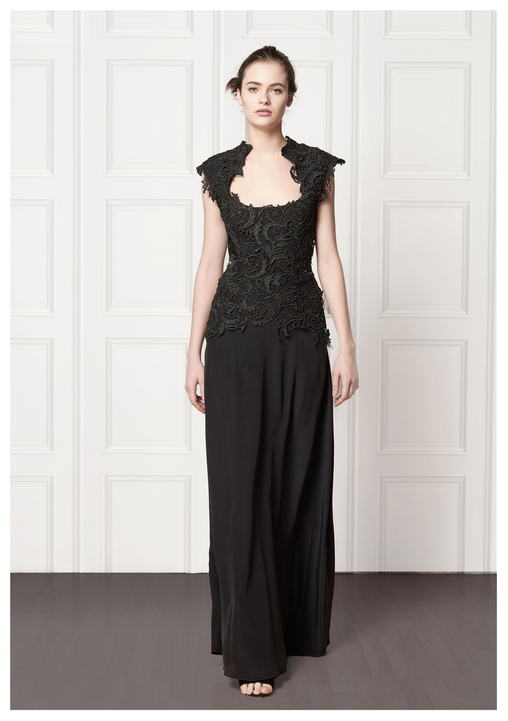 Black, full-length gown with lace overlay and short capped lace sleeves
