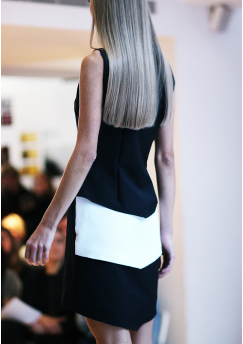 Contemporary sleeveless black and white dress detailed with monochrome chevrons