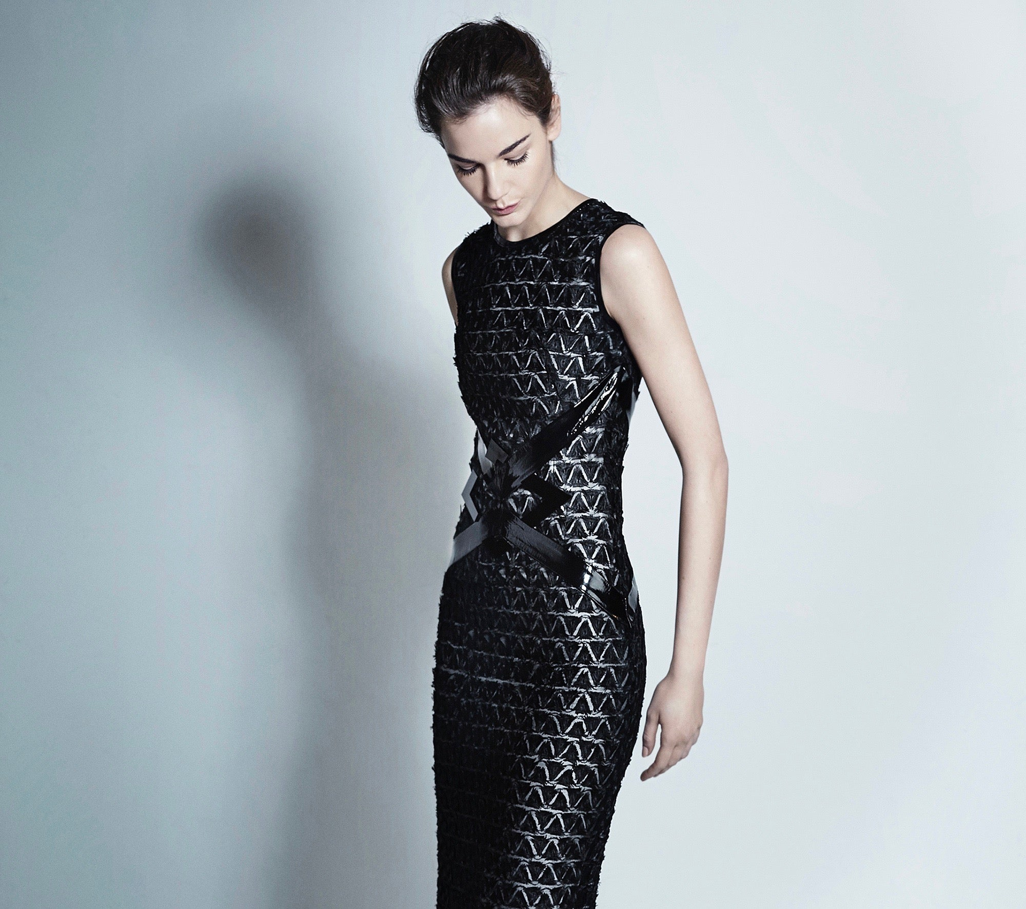 Sleeveless, over the knee dress crafted from Italian geometric lace with leather details