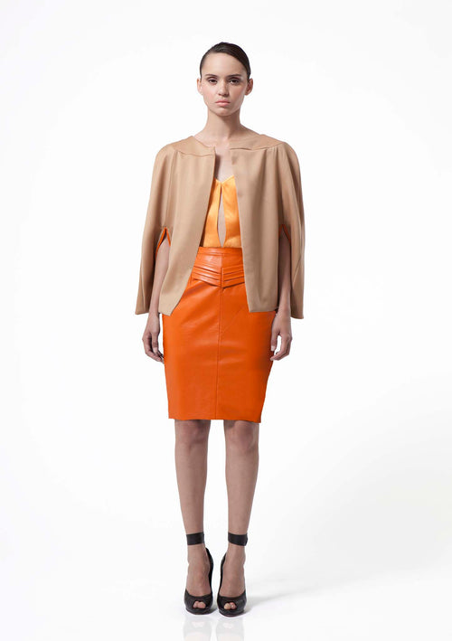 Classic camel wool cape finished with a hot orange lining