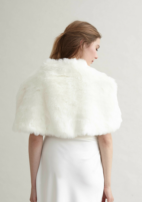 Snow white faux fur cape detailed with a delicate diamanté clasp and chain fastening