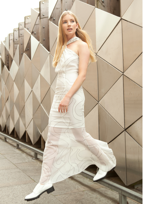 White dress with a twisted halterneck, fishtail style skirt and wave print