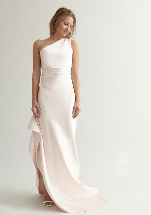 One shoulder, blush white bridal gown with a small train