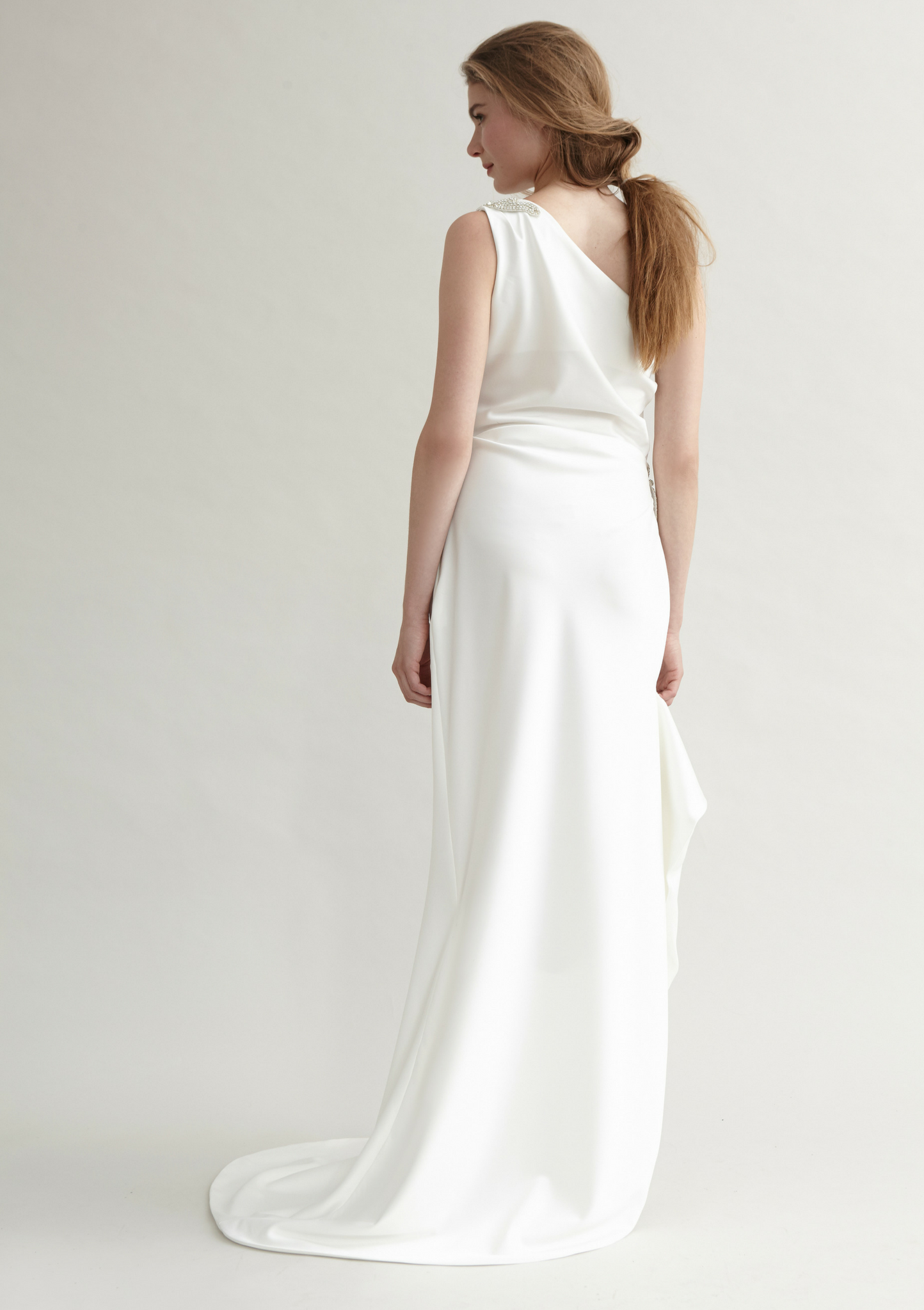 One shoulder, white bridal gown with a small train