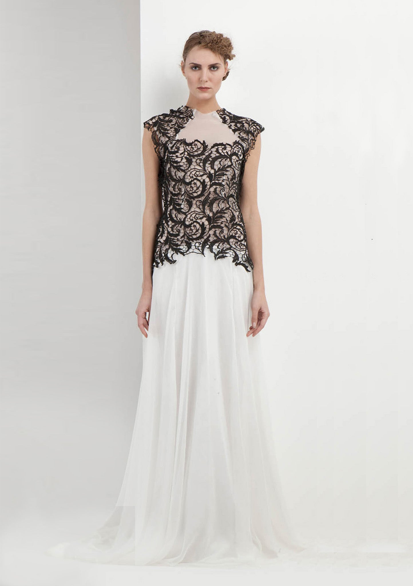White full-length gown with black lace overlay and short capped lace sleeves